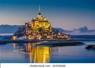 Beautiful view of famous Le Mont Saint-Michel tidal island in beautiful twilight during blue hour at dusk, Normandy, northern France