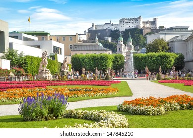 Beautiful view of famous Mirabell Gardens with the old historic Fortress Hohensalzburg in the background in Salzburg, Austria