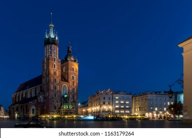 Beautiful view of the famous Saint Mary's Church Basilica and the main market square in the historic center of Krakow, Poland in the blue hour light