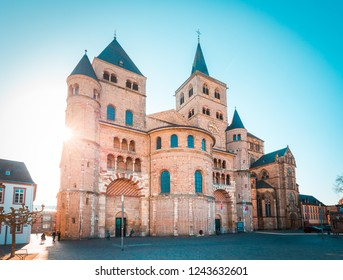 Beautiful view of famous Trierer Dom (High Cathedral of Trier) in beautiful golden morning light in summer, Trier, Germany