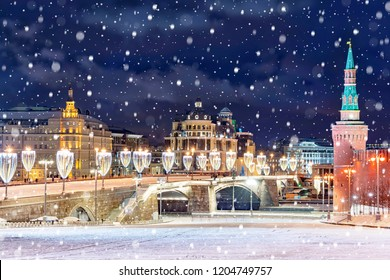 Beautiful view of of festive illuminated bridge over Moscow River near Red Square at night in Moscow, Russia.