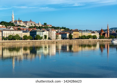 Beautiful view of Fisherman's Bastion reflected in the Danube River in Budapest, Hungary
