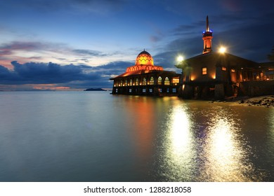 Beautiful vIew of floating mosque during sunset and daylight. Knowned as Al Hussain Mosque located beside Kuala Perlis to Langkawi Jetty, Perlis, Malaysia. It may have noise due to taken in low light.