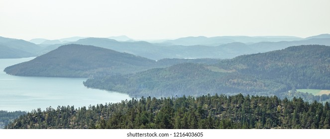 Beautiful view of foggy archipelago, mountains, forest and sea. Skule mountain, high coast in northern Sweden.