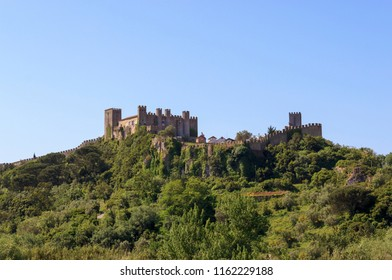 Beautiful view of the fortress. The ancient castle and wall of Obidos, Portugal.One of the most popular tourist destinations. Summer sunny day.
