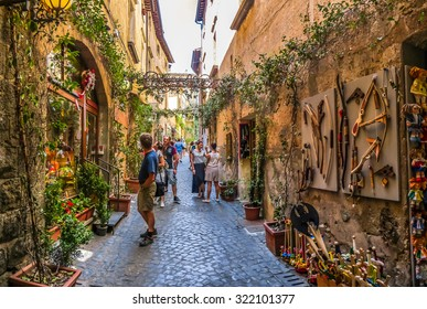 Beautiful view of frisky alley with ancient buildings at square near the Cathedral of Orvieto (Duomo di Orvieto), Umbria, Italy