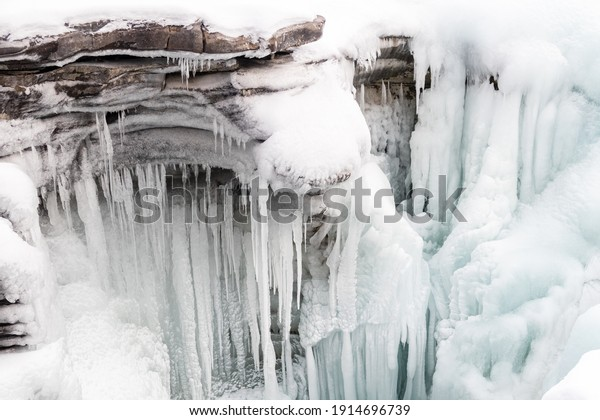 Beautiful view of the frozen Athabasca Falls in winter, Canada