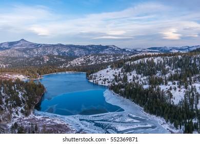 Beautiful view frozen lake in Eldorado national forest, Sierra Nevada mountains.