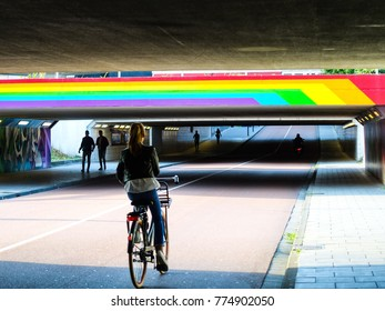 Beautiful view of a girl riding a bike on Eindhoven, Netherlands
