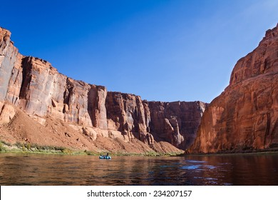 beautiful view of the Glen Canyon from the colorado river with huge colorful sandstone cliffs