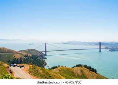 Beautiful view of the Golden Gate bridge in San Francisco from above with Alcatraz island behind it.