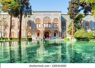 Beautiful view of the Golestan Palace and scenic pond with emerald water in Tehran, Iran. The Golestan Palace is a popular tourist attraction of the Middle East. Traditional Persian exterior.