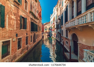 Beautiful view of Grand canal in Venice with colorful houses and torists in Gondolas