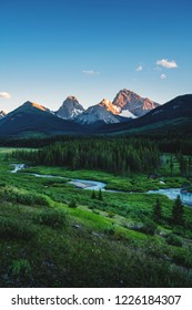 Beautiful view from the gravel road above Canmore near to Spray Lakes reservoir, land of black and grizzly bears, with a river in the foreground and the mountains in the backgroud lit by sunset light