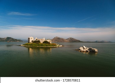 A beautiful view at Grmozur Fortress ruin at the island Grmozur in Lake Skadar National Park in Montenegro, famous tourist attraction.