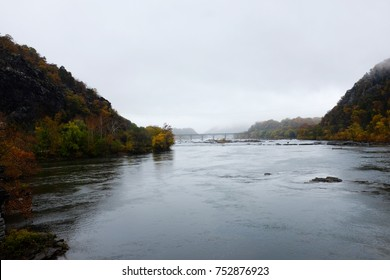 Beautiful view of Harpers Ferry civil war historic town in west Virginia on a misty day during the fall season with colored tree leaves by the Potomac and Shenandoah river