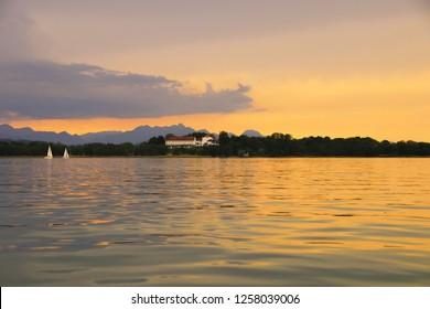 Beautiful view to Herreninsel - Herrenchiemsee, Sundown at Lake Chiemsee, Bavaria - Germany