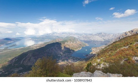 A beautiful view from a high mountain and a bluer sky and white clouds are reflected in the water in the Boka Bay and the sea away in Montenegro