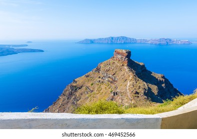 Beautiful view of hill Skyros at village of Imerovigli and morning sunlight at Caldera on volcanic Santorini island, Greece, Mediterranean sea, Europe