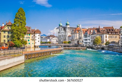 Beautiful view of the the historic city center of Lucerne with famous baroque Jesuit Church St Franz Xaver on a sunny day with blue sky and clouds in summer, Canton of Lucerne, Switzerland