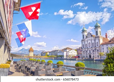 Beautiful view of the the historic city center of Lucerne with Jesuit Church and river Reuss from a street cafe on sunny summer day, Canton of Lucerne, Switzerland