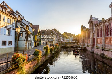 Beautiful view of the historic town of Colmar, also known as Little Venice, boat ride along traditional colorful houses on idyllic river Lauch in summer, Colmar, Alsace, France