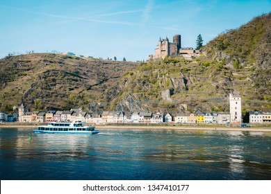 Beautiful view of the historic town of St. Goarshausen with famous Rhine river on a scenic sunny day with blue sky in spring, Rheinland-Pfalz, Germany