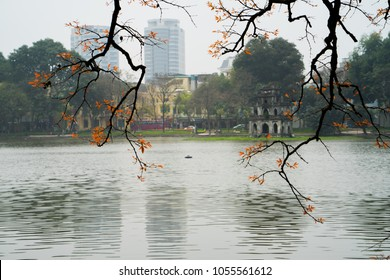 Beautiful view to HoanKiem lake, Hanoi capital, VietNam when changing season with leaflet. It is time to traval and walk arround.