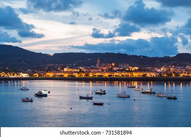 Beautiful view from Hondarribia (Basque Country) with the typical boats on the river.