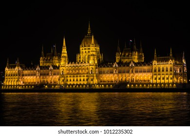 Beautiful view of the Hungarian Parliament by night on the danube, Budapest