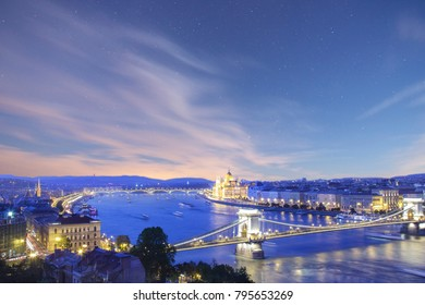 Beautiful view of the Hungarian Parliament and the Szechenyi chain bridge across the Danube in the panorama of Budapest at night, Hungary