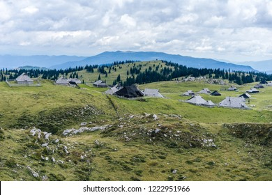 Beautiful view of the huts and cottage on Velika Planina, Kamnik Savinja alps, Slovenia. Mountain landscape with pastures amd shepard houses.