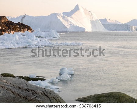 Beautiful view of icebergs in Ilulissat, Greenland. Global warming and climate change concept