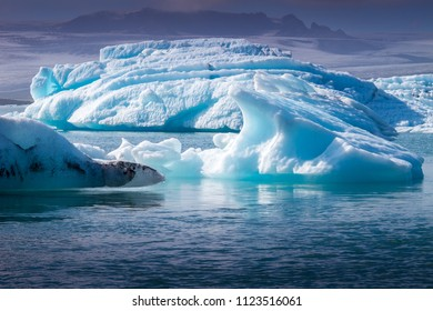 Beautiful view of icebergs in Jokulsarlon glacial lagoon at sunset. Vatnajokull National Park, Iceland, Europe. Landscape photography