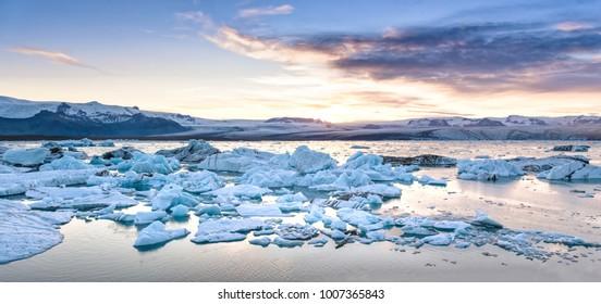Beautiful view of icebergs in Jokulsarlon glacier lagoon at sunset, Iceland, global warming concept