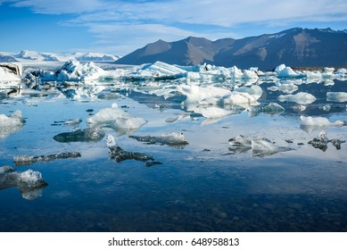 Beautiful view of icebergs in Jokulsarlon glacier lagoon, Iceland, global warming concept, selective focus