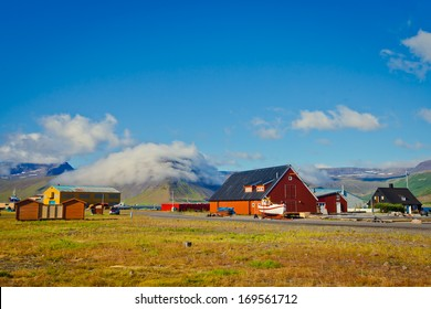 Beautiful view of icelandic fjord and city in iceland with red houses, ships and yachts