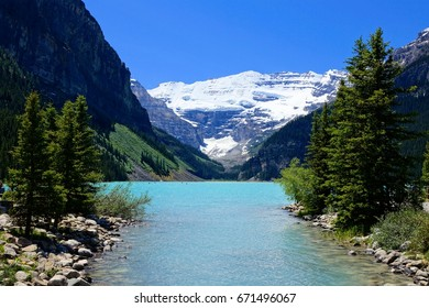 Beautiful view of the iconic Lake Louise, Banff National Park with blue skies, Alberta, Canada