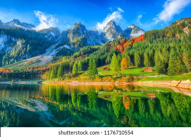 Beautiful view of idyllic colorful autumn scenery with Dachstein mountain summit by Gosausee mountain lake in fall Salzkammergut region Upper Austria Austria