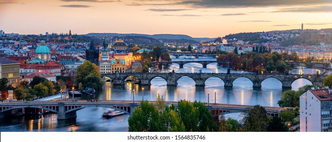 Beautiful view to the illuminated cityscape and bridges of Prague, Czech Republic, including the famous Charles Bridge and old town just after sunset time