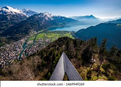 A beautiful view of Interlaken town, Eiger, Mönch and Jungfrau mountains and of Lake Thun and Lake Brienz from Two Lakes Bridge viewing platform on Harder Kulm, Switzerland.