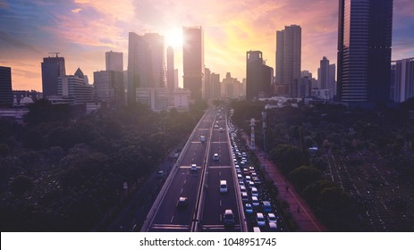 Beautiful view of Jakarta cityscape with modern buildings silhouette at sunset. Aerial photo shot from a drone.