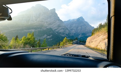 A beautiful view of Kananaski Country through the windshield of a 4x4. It was taken at sunset while on a road trip from Banff National Park, Alberta, Canada.