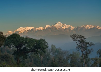 Beautiful view of Kanchenjunga mountain range with first daylight on it, at the background, moring light, at Sikkim, India