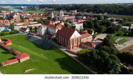 A beautiful view of Kaunas castle among other small buildings in  Lithuania