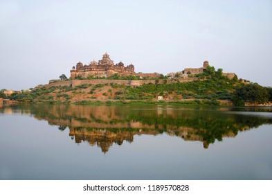Beautiful view of lake and Datia Palace. Also known as Bir Singh Palace or Bir Singh Dev Palace. Datia. Madhya Pradesh