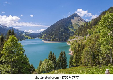 A beautiful view of a lake surrounded by mountains in Longrin lake and dam Switzerland, Swissalps