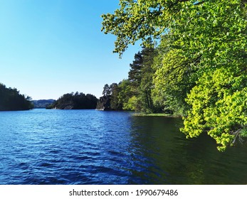 A beautiful view of a lake surrounded by trees, Larvik, Norway
