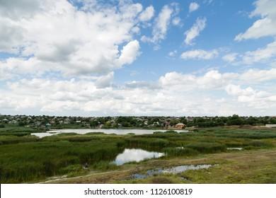 Beautiful view of the lake and the village. Beautiful views along the highway Chisinau Cimislia. The Republic of Moldova.