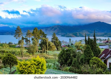 beautiful view from the lakeside with mountains in the background in the morning with blue water